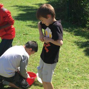 Two boys rinsing produce